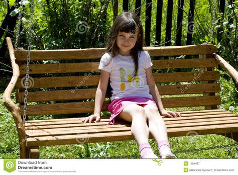 kid on bench pretty child on bench stock image image of pleasant