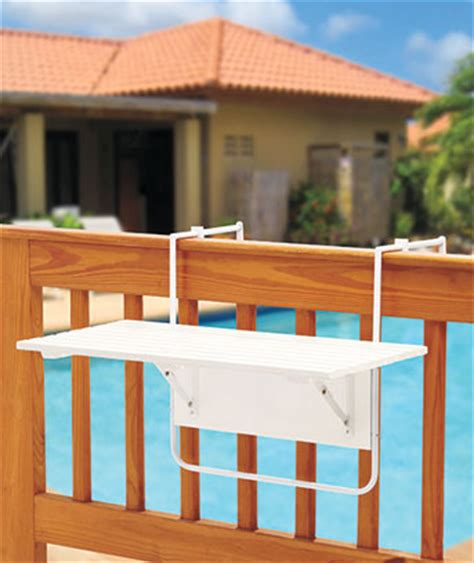 folding or white wood table hangs on deck railing