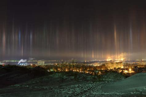 light pillars angels are descending to earth through eerie light pillars