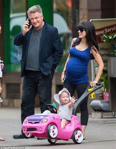 Alec baldwin dotes on pregnant wife hilaria as she dresses her growing