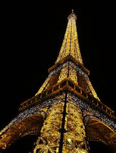 eiffel tower decked out with christmas lights photo l c