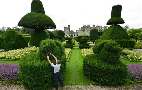 definition topiary staff at world s largest topiary garden begin annual six