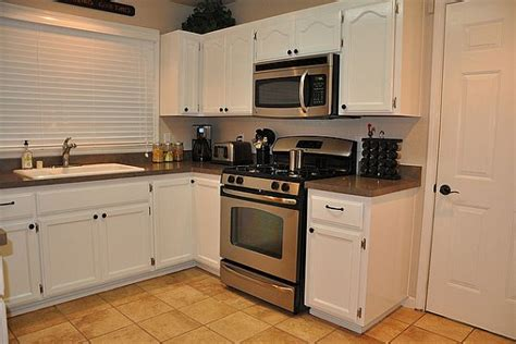 small kitchens with white cabinets and black appliances white small kitchen cabinets quicua