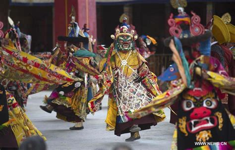 tibetan buddhist monks perform to greet tibetan new year 1