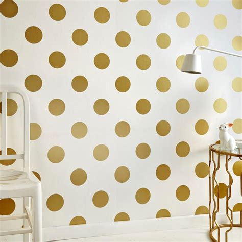 wallpaper with gold spots dotty wallpaper in gold from the kids collection by graham