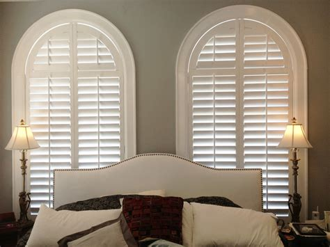 Fan Shades For Arched Windows Designs Arched Plantation Shutters By The Louver Shop Make A Great Backdrop For This Master Bedroom