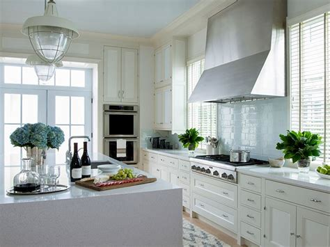 coastal kitchen features cream cabinets accented