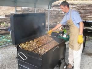 marlin flipping chicken on a bbq42 chicken cooker