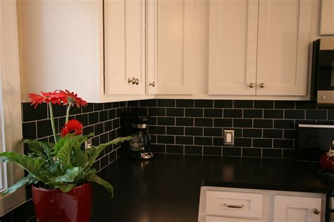 black subway tile kitchen backsplash white cabinets black subway tile black granite