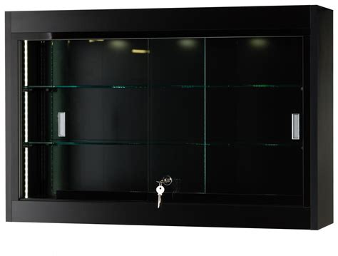 Metal Frame Cabinet Doors This Display Cabinet Features A Curved Black Metal Frame For A Modern Looking Wall Display This