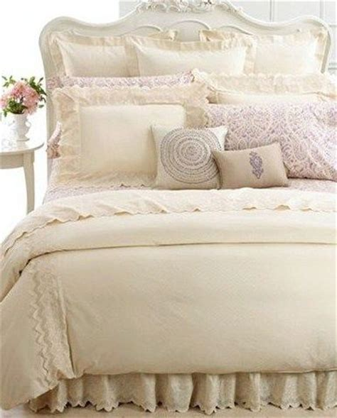 cream colored comforter cream and lavender bedding with lace detailing cream