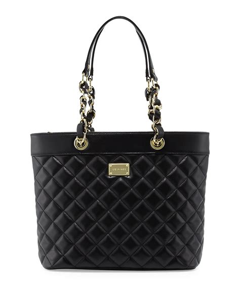 st quilted leather tote bag in black lyst