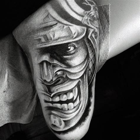 asian style black and white samurai mask tattoo on arm