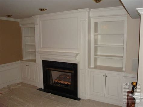 Asbestos Fireplace Surround by Fireplace Surround Moldings And Built In Cabinetry Mitre Contracting Inc