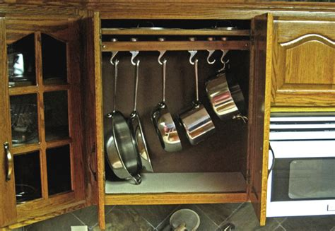 kitchen storage ideas for pots and pans picture of hooks in cabinets