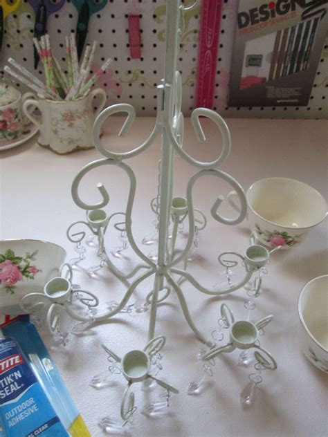 hometalk outdoor candle chandelier turned coffee cup planter