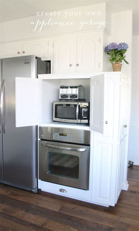 microwave hideaway cabinet for the home pinterest appliances kitchen appliances and appliance garage on