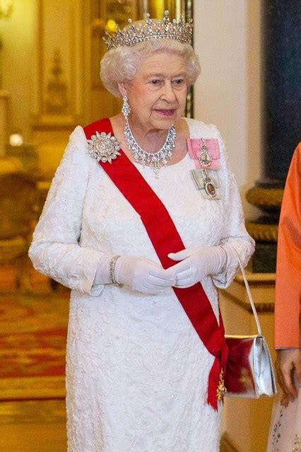 queen elizabeth purse queen launer handbags sales soar colourful vogue co uk