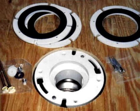 Raising the level of a caste iron toilet flange to the