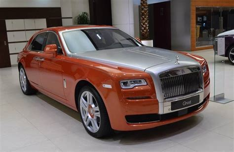 roll royce orange orange metallic rolls royce ghost looks cool