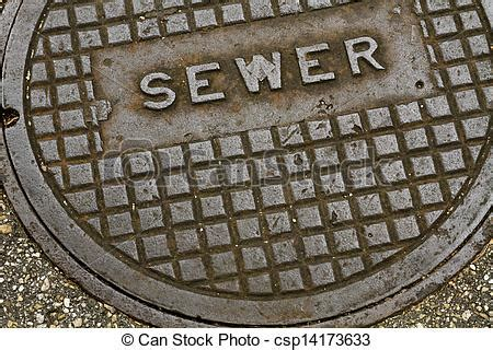 steel sewer manhole cover lid. an old grungy steel metal