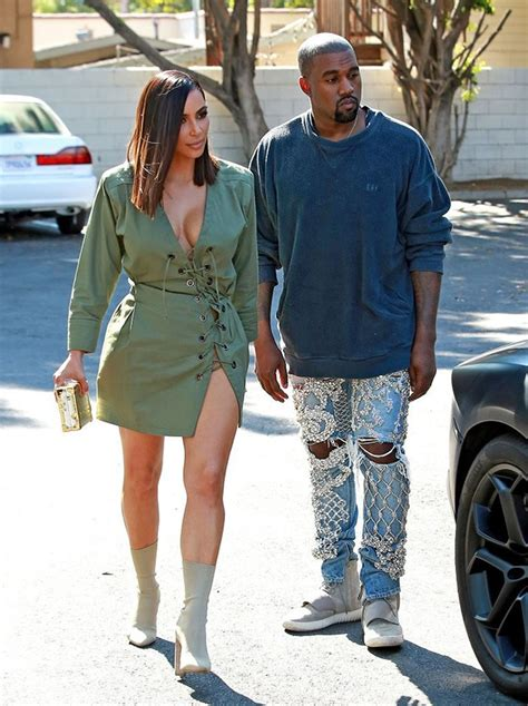kanye sports balmain jeans and yeezy sneakers while kim