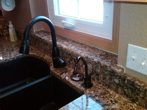faucet on granite countertops kitchens amp baths