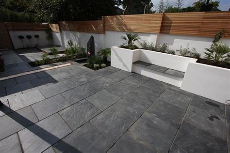 Black Limestone Patio Slabs by Blue Black Slate Paving In A Garden
