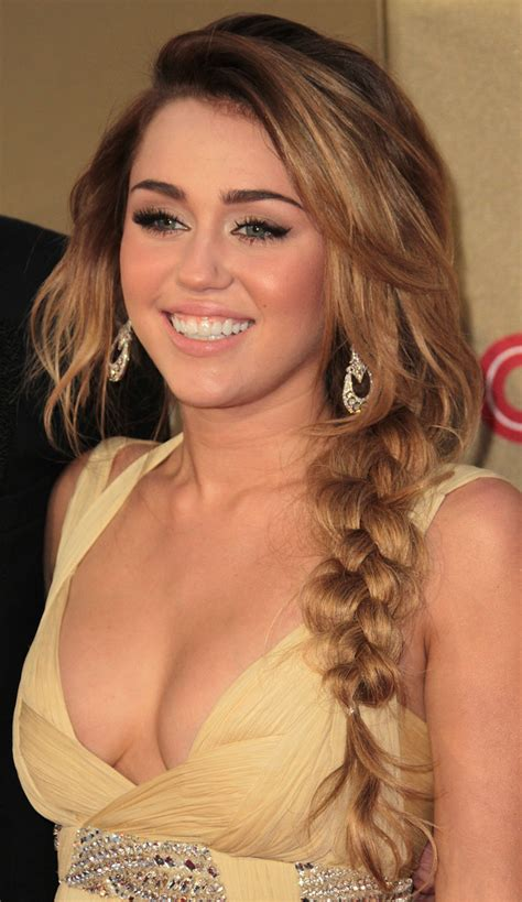 top 9 miley cyrus hairstyles styles at life more pics of miley cyrus long braided hairstyle 4 of 8