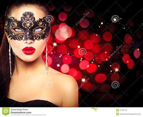 Masker Glowing wearing carnival mask stock photo image of