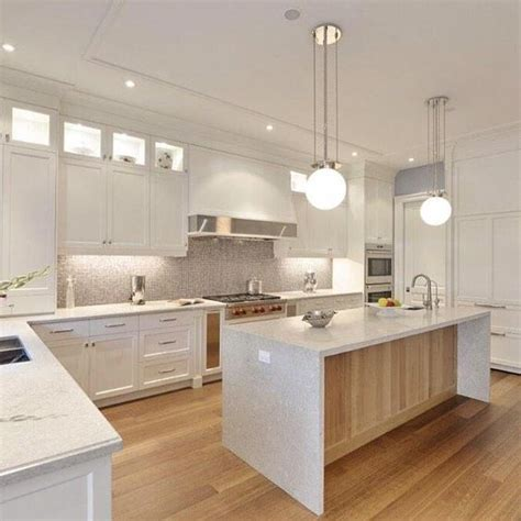 this kitchen features a beautiful caesarstone countertop