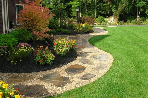gravel walkway with flagstone inlay front yard and back