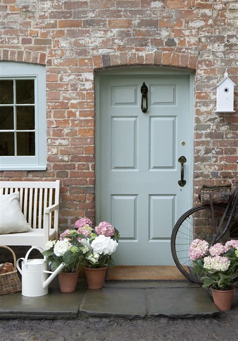 blue front door color for brick house mixed with christmas front door drama elements of style blog
