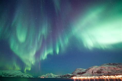 norway northern lights tour ice hotel northern lights tromso fjord travel norway