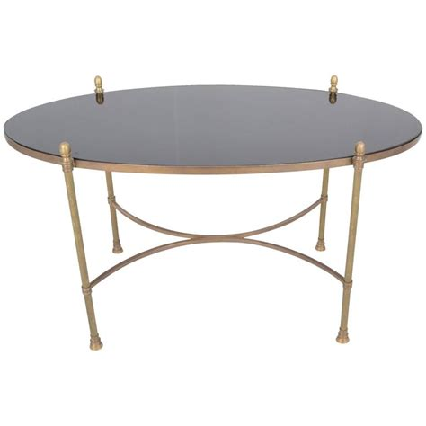 modernist granite top cocktail table in the style of tommy neoclassical style brass and black granite cocktail table
