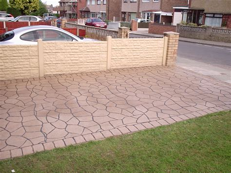 pin concrete driveway and brick walkway on