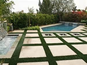 Large Pavers For Patio Poolside Patio With Large Square Pavers The Polygon Shaped Pool Includes Two Mini Waterfalls And