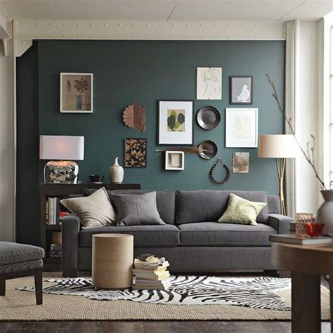 what color walls with grey couch dark teal colored accent wall in living room with grey