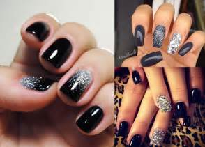 Black nail polish manicure with black lacquer or black pattern photo