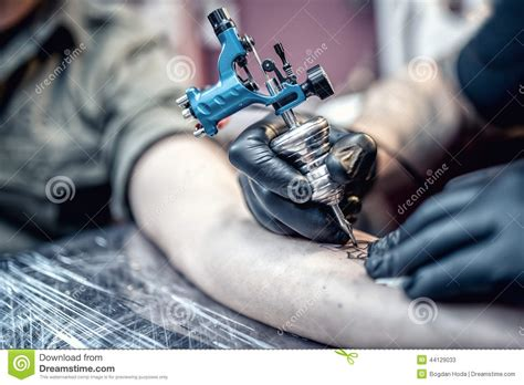 tattoo tool kit tattoo artist drawing on client with special tools stock