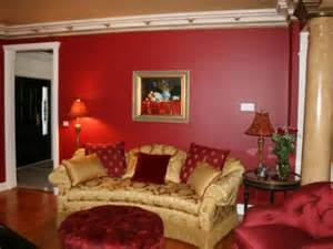Victorian themed living room with red furniture and walls