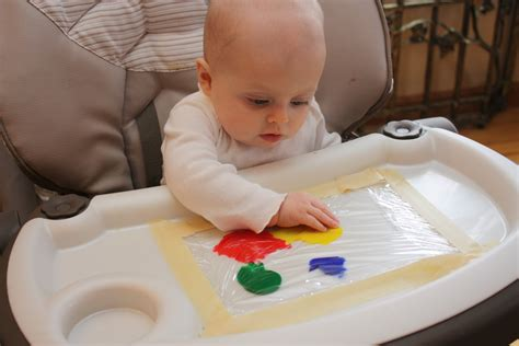 painting baby a tale of two babies baby finger painting