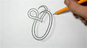 letter o and heart combined tattoo design ideas for