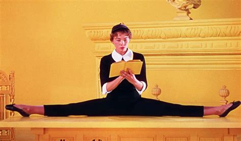 Doing On The by Wearing Beret Doing Splits While Reading Book