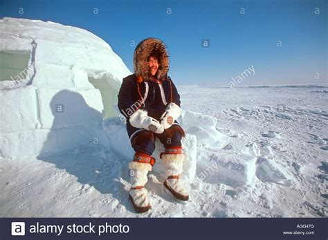 alaskan eskimo alaskan eskimo sitting outside igloo nome ak western winter stock photo royalty