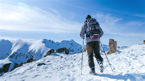 snow hiker hiking adventure mountain travel outdoor