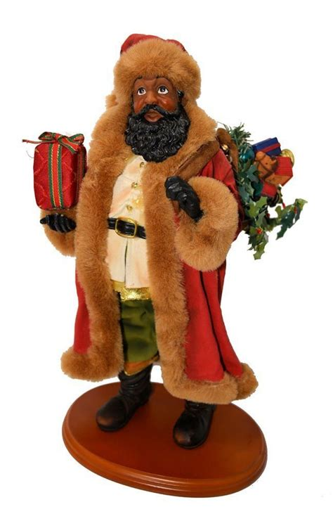 black santa claus figurine on wood stand 14 quot tall black