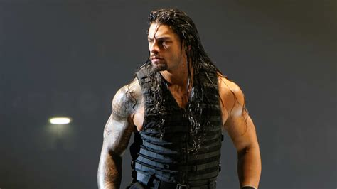 rock and roman reigns wwe roman reigns set to miss wrestlemania following