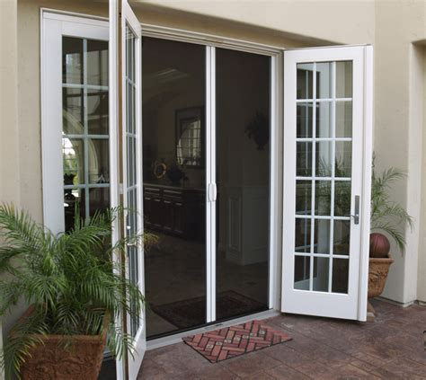 screen door for outward swinging door retracting door our outdoor retractable screen doors are