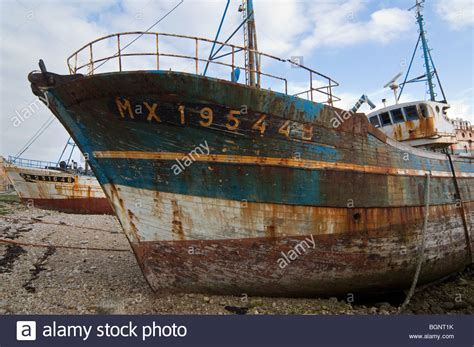 old boat wrecks for sale wrecks of old trawler fishing boats in the harbour of